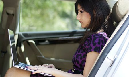 shilpa_ahuja_car_work_wear_power_dressing_purple_dress_fierce_woman_professional_pearls_office_black_heels_laptop